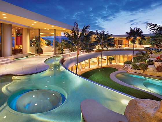 the portabello estate features a two level grotto with a pool two spas a tunnel slide and a swim up bar - Swimming Pools With Grottos