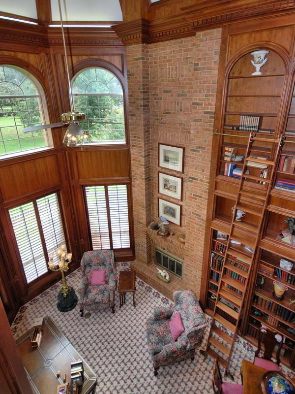 a true 2story library with rolling ladder