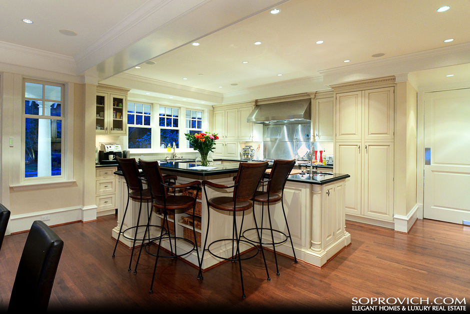 Custom gourmet kitchen with center island pricey pads for Kitchen with centre island