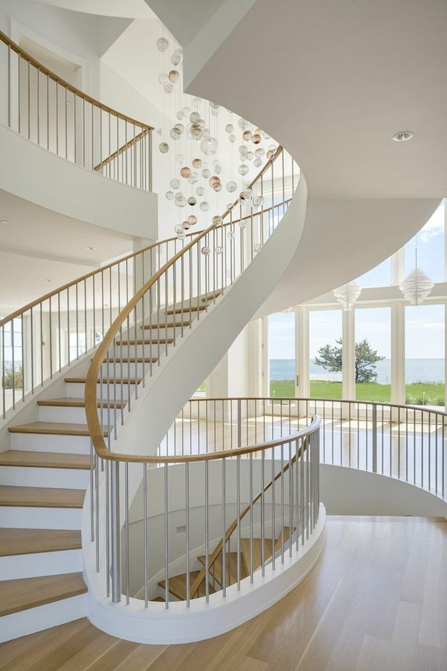 Bon Highlighted By A 3 Story Foyer And Chandeliered Spiral Staircase Opening  Into The Main Living Areas.