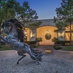 Incomparable 23,500 Sq. Ft Home On 64-Acres With 10-Car Showroom, Stables, 3 Swimming Pools, & Indoor Tennis Court Yours For $16-Million (PHOTOS)