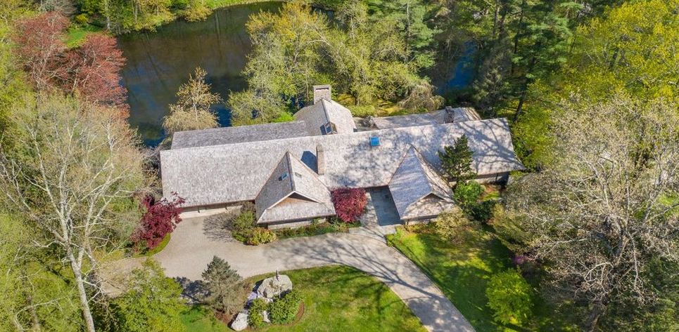 1970s Frank Lloyd Wright-Inspired Home on Horseneck Pond lists in Greenwich for $3.8M (PHOTOS)